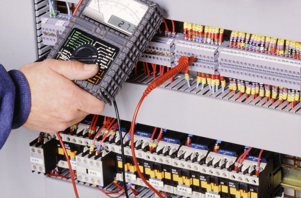 Electrician installing home automation equipment