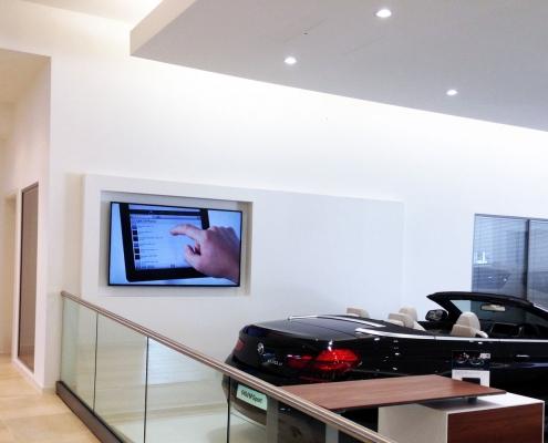 Car showroom AV install and corporate lighting solutions image