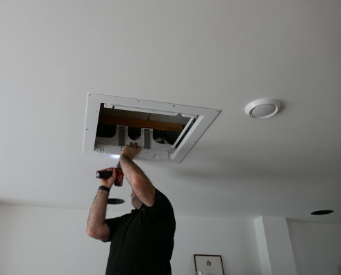 Intelligent home specialists installing TV Projector